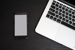 Mobile Phone white background with Laptop Keyboard Stock Photo