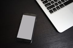 Mobile Phone white background with Laptop Keyboard Royalty Free Stock Photos