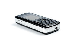 Mobile phone. On a white background a side view Royalty Free Stock Photos
