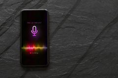 Free Mobile Phone With Activated Voice Assistant. Stock Photo - 125806420