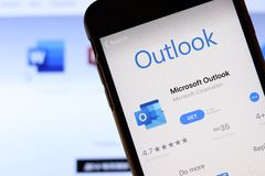 Free Mobile Phone With Microsoft Outlook Icon On Screen Close Up With Website On Laptop. Blurred Background Royalty Free Stock Photos - 163856838