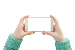 Mobile phone in woman hand. Horizontal position with isolated screen and background Royalty Free Stock Images