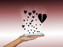 Mobile phone in woman hand. With many black hearts. Stock Photo