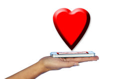 Mobile phone in woman hand. With red hearts. Stock Images