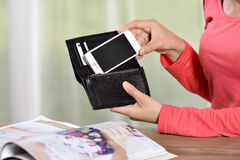 Mobile phone in a womans hand Royalty Free Stock Photography