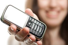 Mobile phone in women hand Stock Image
