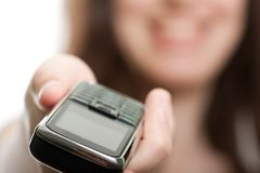 Mobile phone in women hand Royalty Free Stock Photos