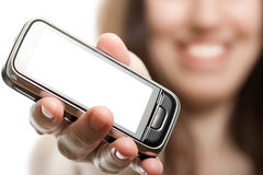 Mobile phone in women hand Royalty Free Stock Photo