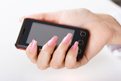 Mobile phone in women hand Royalty Free Stock Images