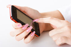 Mobile phone in women hand Royalty Free Stock Image
