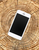 Mobile phone on wooden cracked background Royalty Free Stock Images
