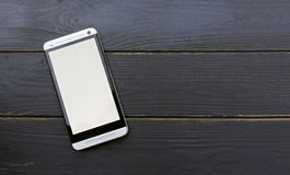 Mobile phone on wooden table royalty free stock images