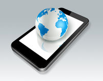 Mobile phone and world globe Stock Images