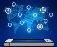 Mobile phone and a world map with connection icon Stock Image