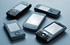 Mobile phones. Different types of cell phones Stock Photos