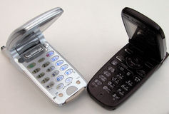 Mobile phones. A pair of open mobile phones. Japanese keypads Stock Images