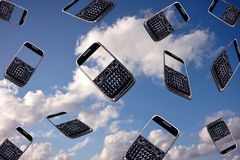 Mobile phones in the air Royalty Free Stock Photography
