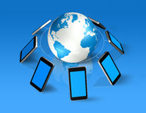 Mobile phones around a world globe Royalty Free Stock Image