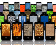 Mobile phones with different abstract textures Royalty Free Stock Photos