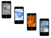 Mobile phones with different elements on the white Stock Photos