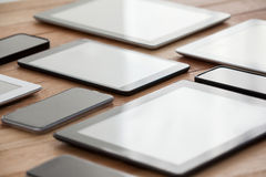 Mobile phones and digital tablets on table. Close-up of mobile phones and digital tablets on table stock photography