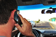Mobile phones and driving Stock Image