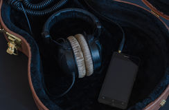 Mobile phones with headphones in  case. Royalty Free Stock Photo