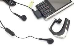 Mobile phones with headset Royalty Free Stock Images