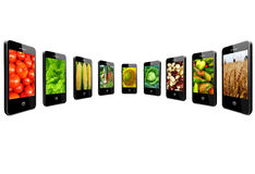 Mobile phones with images of different vegetables Royalty Free Stock Photos