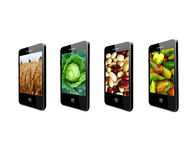 Mobile phones with images of different vegetables Royalty Free Stock Image
