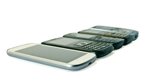 Mobile Phones. New and Old Models Of Mobile Phones on white background Stock Image