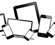Mobile phones, notebook and tablet pc Stock Photos