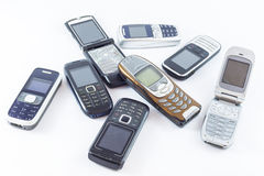 Mobile phones. Old mobile feature phones  on white Royalty Free Stock Image