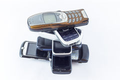 Mobile phones. Old mobile feature phones  on white Stock Image