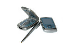Mobile phones and pen Stock Image
