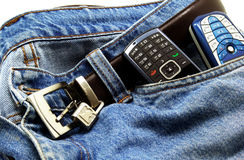 Mobile phones in the pocket. Two mobile phones in the pocket of a jeans Royalty Free Stock Photos