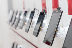 Mobile phones in showroom. New mobile phones in showroom Royalty Free Stock Photos