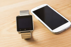Mobile phones, smart watches and laptop computers Stock Images