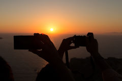 Mobile Phones Sunset Royalty Free Stock Images