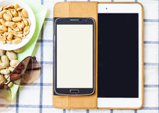 Mobile phones and tablets on a white background. Stock Image