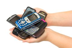 Mobile phones in woman hands Stock Images