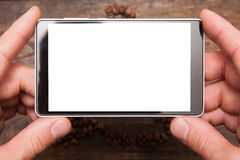 Mobile photography. Blank phone in hands Stock Photo