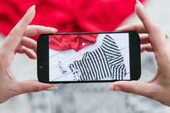 Mobile photography online clothes store retail stock photography