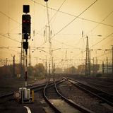 Mobile photography tone confusing rail tracks dusk. Moble photography lo-fi styled image of confusing urban railway tracks with ines and overhead cables and a royalty free stock photos
