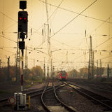 Mobile photography tone red train on railway track. Moble photography lo-fi styled image of a red commuter train on an urban railway track with confusing lines stock photos