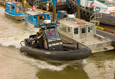 Mobile police to the rescue on the fraser river n canada Royalty Free Stock Image