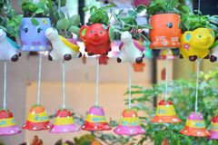 Mobile & x22;Pork Doll& x22; - Decorated from rich. Mobile & x22;Pork Doll& x22; - Decorated from rich earthenware with beautiful ornamental plants Stock Image