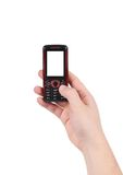 Mobile push-button telephone in hand. Royalty Free Stock Photo