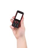 Mobile push-button telephone in hand. Stock Photos