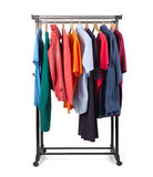 Mobile rack with clothes on white background Royalty Free Stock Photos